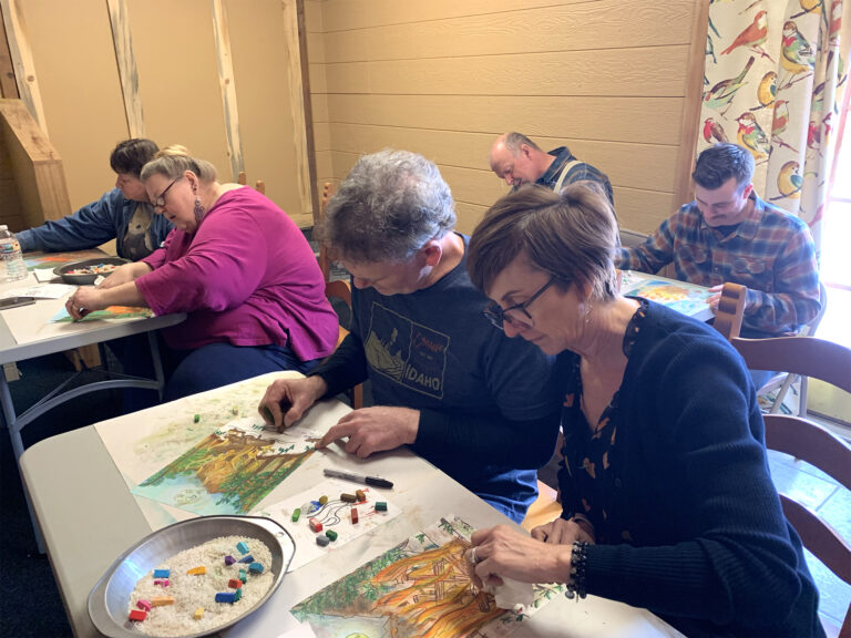 adults in class learning to paint